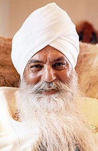 smiling_yogi_bhajan_seated.jpg